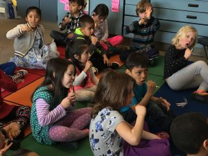 Supervised flossing and brushing after lunch in a Kindergarten classroom