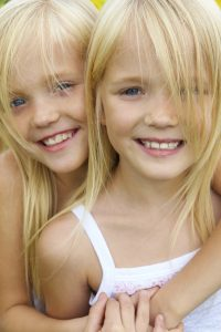 Twin girls with smiles