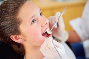 Dentist examining patientt