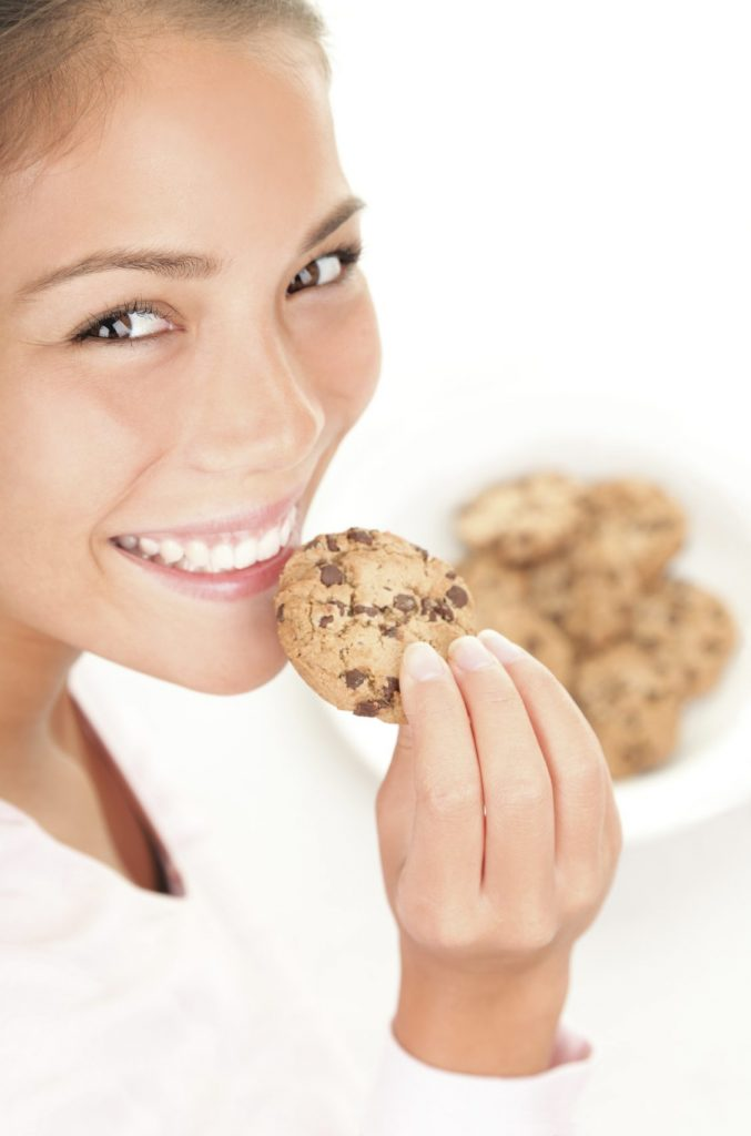 Women about to eat a cookie
